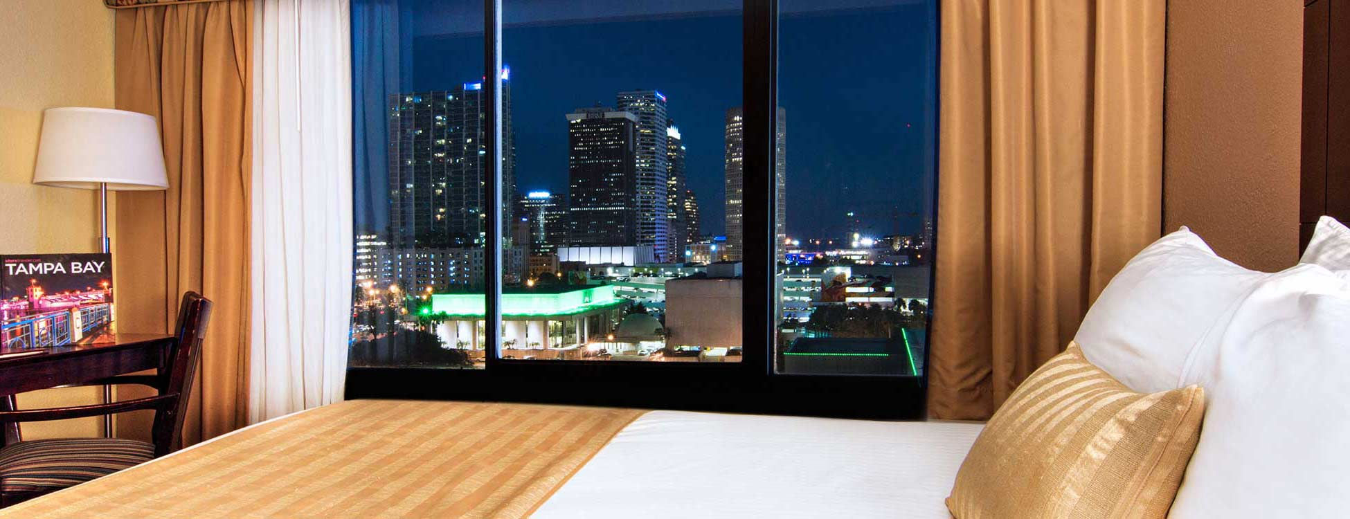 view of city skyline at night from guest room